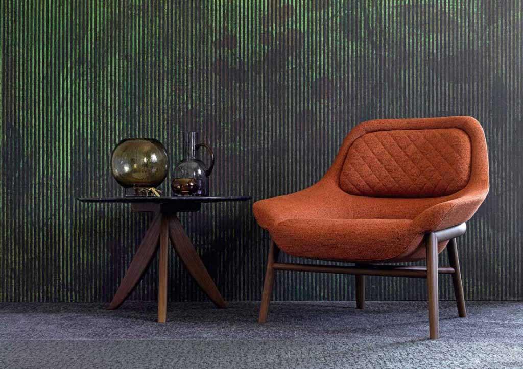 complementos de decoración berto: sillón hanna de tela naranja y mesa de centro redonda circus.